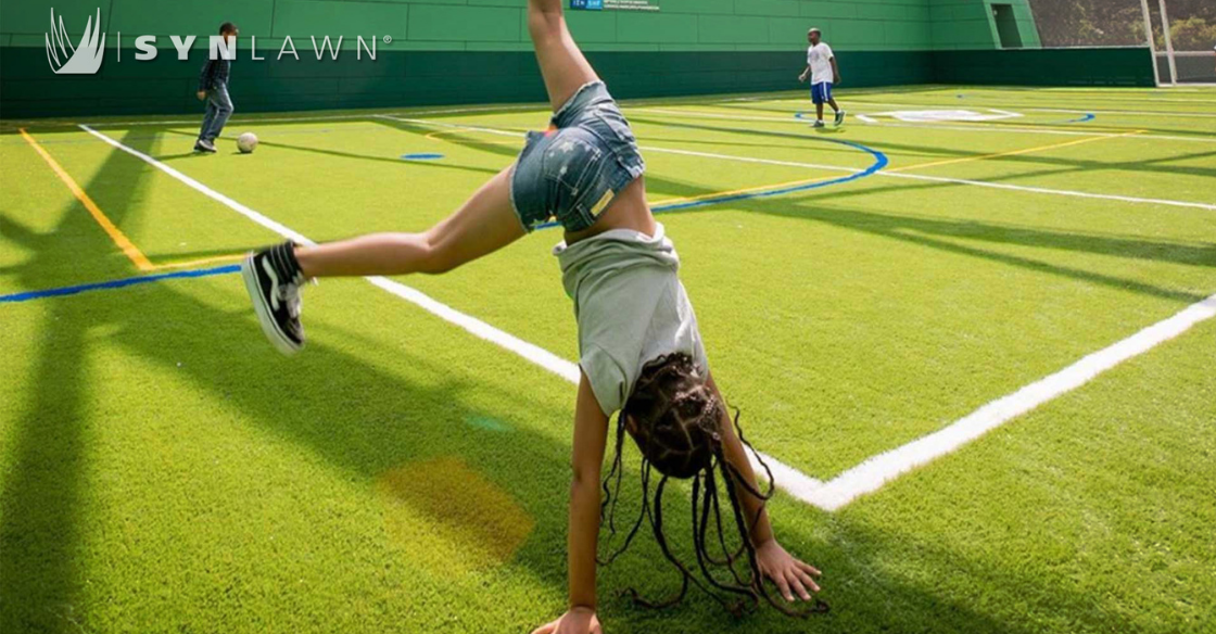 Girl playing on athletic turf
